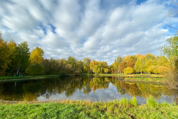 Autumn landscape. View of the lake autumn forest, beautiful sky