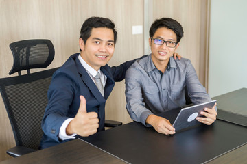 Picture of successful two asian businessman is sitting in office and planning work new idea