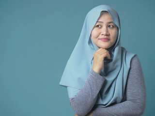 Muslim Businesswoman Thinking Something, Looking to the Side