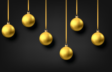 Fotomurales - Golden  hanging Christmas balls isolated on black  background.