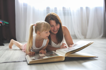 mom and daughter watching together photo album