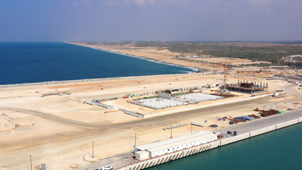 Aerial Image over Harbor Under Construction in Israel Drone view over Ashdod New port under Construction with coastline in the background, Israel