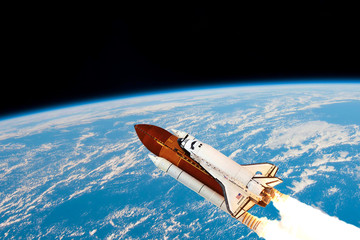A space shuttle takes off into Earth orbit to mission on mars.Elements of this image furnished by NASA