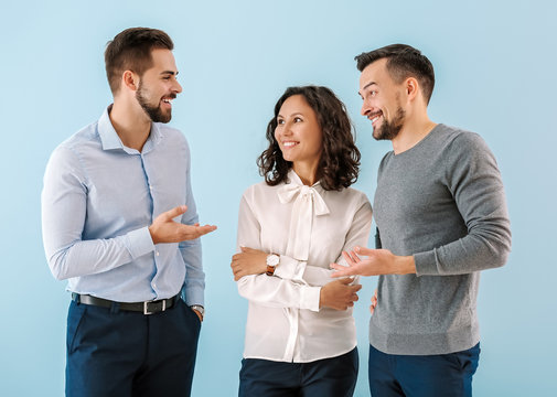 Portrait of young business people on color background