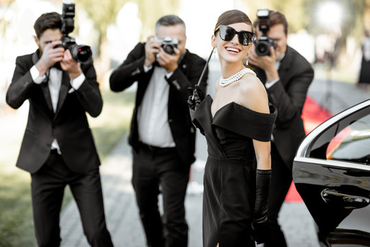 Photo reporters photographing actress ariving on the awards ceremony