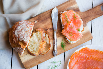 Sandwithes with smoked salmon and creamy cheese on bread