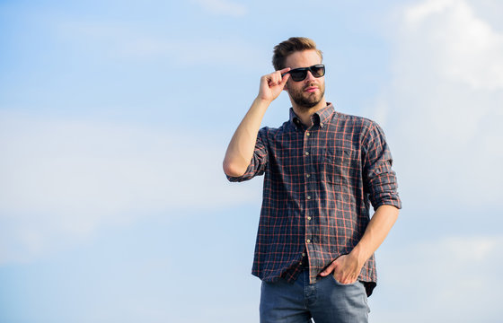 Handsome macho. men beauty and sexuality. Real men. macho man unshaven face. male fashion style. looking very trendy. businessman in glasses. confidence and charisma. sexy man sky background