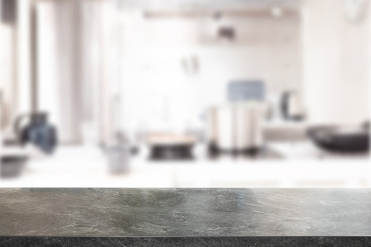 Black Marble Stone table top and blurred kitchen interior background with white light filter - can be used for display or montage your products.