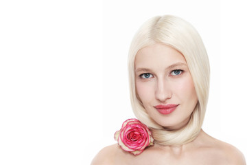 Portrait of young beautiful blonde woman with clean makeup and pink rose, copy space