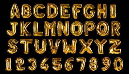 Set with golden foil balloons in shape of letters and numbers on black background