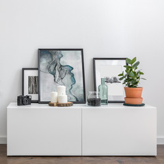 White sideboard and decorative accessories