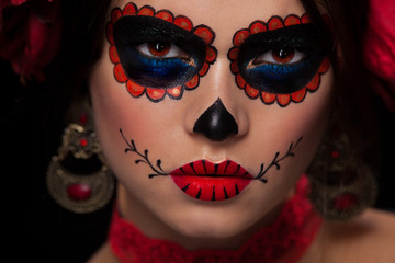 White sugar skull Dia De Los Muertos  on poster for Halloween party with creative make-up or holiday on dark background with copyspace. Beautiful Model, close up in studio.