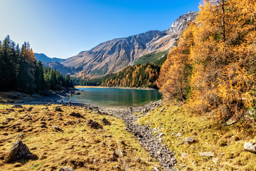 Wall Mural - Scenic view of mountain lake at autumn sunny day. Europe, Austria,Tyrol, Lake Obernberg, Stubai Alps.