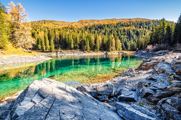 Wall Mural - Mountain lake at sunny day. Alps, Austria,Tyrol, Lake Obernberg, Stubai Alps.