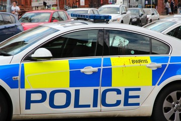 BIRMINGHAM, UK - APRIL 19, 2013: Police vehicle with blood stains on door in Birmingham, UK. 126,818 police officers worked in the 43 British police forces in 2015.
