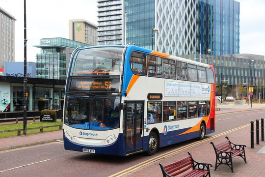 MANCHESTER, UK - APRIL 22, 2013: People ride Stagecoach city bus in Manchester, UK. Stagecoach Group has 16 percent bus market in the UK. Stagecoach UK employs 18,000 people.
