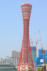 KOBE, JAPAN - APRIL 24, 2012: Kobe Port Tower in Kobe, Japan. The unusual hyperboloid tower is 108m tall and is Kobe's main tourism attraction.