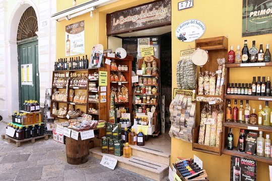 GALLIPOLI, ITALY - MAY 31, 2017: Local cuisine shop in Gallipoli, Italy. With 50.7 million annual visitors Italy is one of the most visited countries.