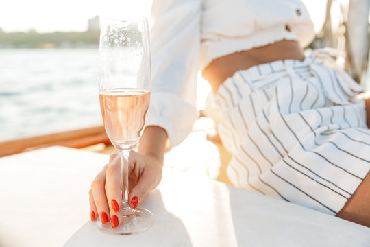 Positive woman with glass of champagne.