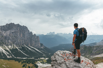 hiker enjoying the view in the dolomites