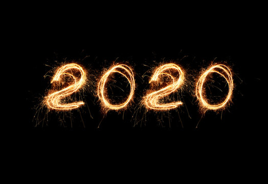 New Year 2020 light. Sparklers draw figures 2020. Bengal lights and letter
