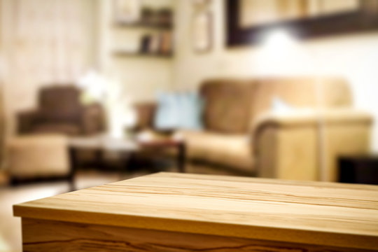 Wooden corner table background of free space for your decoration and blurred home interior