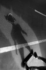 skateboard shadow on the sidewalk