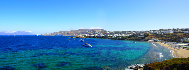 panoramic view of the bay and beach of South Mykonos, famous Greek island of Cyclades in the heart of the Aegean Sea
