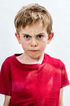 stunned outraged boy frowning for danger, fear or domestic violence