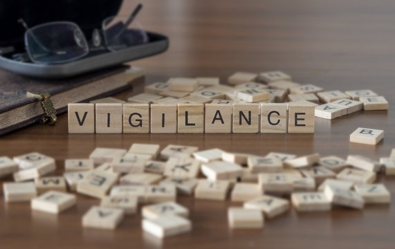 The concept of Vigilance represented by wooden letter tiles