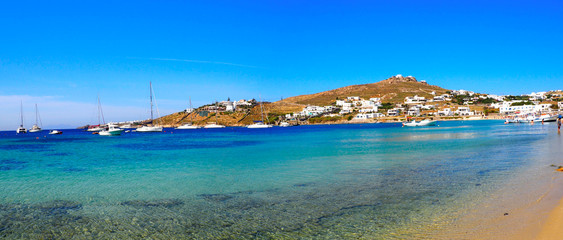 Panoramic view of the South Beach of Ornos in Mykonos, the famous Greek island of Cyclades in the heart of the Aegean Sea