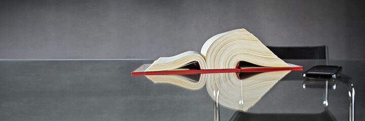 German Law, Book and Smartphone on Glass Table
