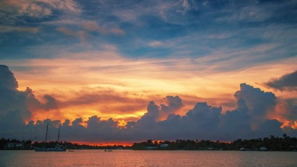 Fotobehang - Beautiful sunrise clouds over ocean water landscape in Miami, Florida. Timelapse, 4K UHD