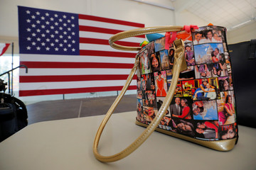 An audience member's bag featuring former First Lady Michelle Obama sits on a table in Durham