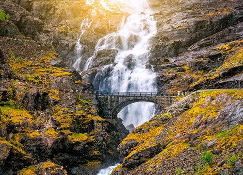stone bridge and waterfall on troll road