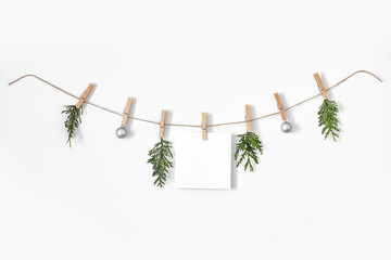 Christmas composition on white wall and free space for your decoration.