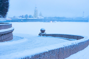 Saint Petersburg. Russia. Spit of Vasilyevsky Island. Fog. Peter and Paul Fortress in winter. Weekend in St. Petersburg. Panorama of the winter Neva. Excursion Vasilyevsky Island. Vacations in Russia