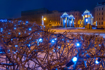 Saint Petersburg. Russia. Lomonosov bridge. Christmas decorations in the center of St. Petersburg. New Year holidays in Russia. View of the night cities. Landscape of the city of St. Petersburg.