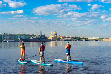 Saint Petersburg. Russia. Sup surfing in St. Petersburg. St. Isaac's Cathedral. Admiralty. Inflatable boards for sup surf. Tourists sail on the Neva. Tourists look at the sights of St. Petersburg.