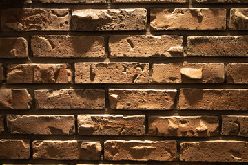 Brown brick in the wall. Close up view of wall brick. Loft design.