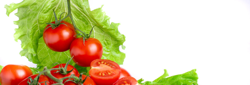 ripe tomatoes with lettuce leaves on a white background