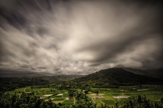 Landscape with green mountains under the storm clouds before the heavy rain
