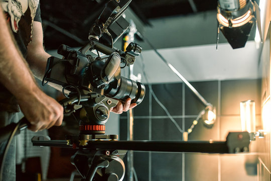 Behind the scenes of filming films or video products and the film crew of the film crew on the set in the pavilion of the film studio.
