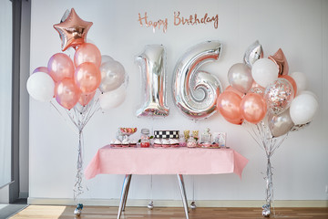 Candy bar and balloons, number 16 from balloons for birthday celebrations