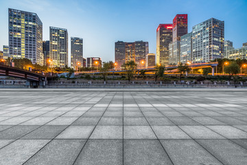 Fotomurales - Empty city square road and modern business district office buildings in Beijing at night, China