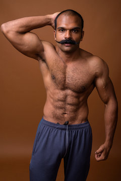 Portrait of muscular Indian man with mustache shirtless