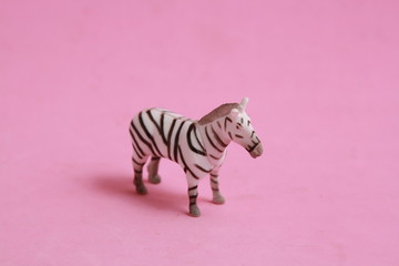 Printed roller blinds Zebra plastic toy with zebra shape in color background