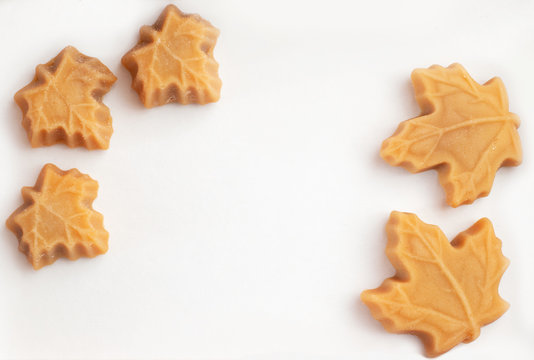 Maple syrup sweets on a white background