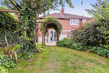 back garden of suburban semi detached house england uk