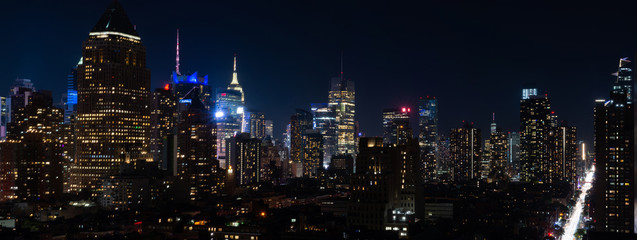 Panoramic night view of Midtown Manhattan and Hell's Kitchen